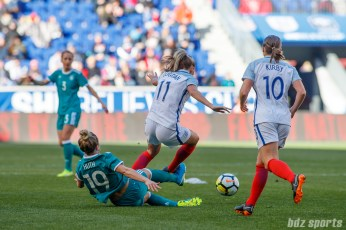 Team Germany forward Svenja Huth (19) slide tackes the ball away from Team England forward Toni Duggan (11)