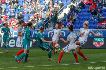 Team Germany forward Alexandra Popp (11) looks to volley the ball past Team England defenders Demi Stokes (3) and Millie Bright (6)