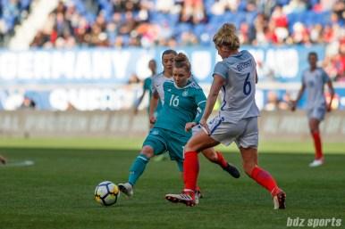 Team Germany midfielder Linda Dallmann (16) takes on Team England defender Millie Bright (6)