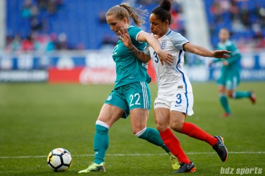 Team Germany midfielder Tabea Kemme (22) protects the ball from Team England defender Demi Stokes (3)