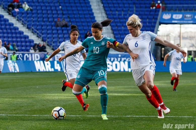Team Germany midfielder Dzsenifer Marozsan (10) takes on Team England defender Millie Bright (6)
