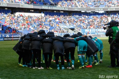 The German women's national soccer team huddle before the start of their game against the England women's national soccer team