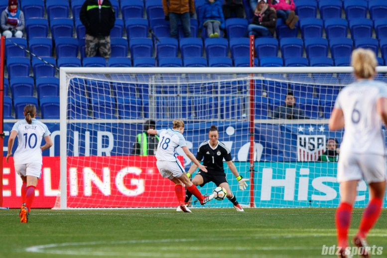 Team England forward Ellen White (18) takes a breakaway shot on goal to score her and England's second goal of the game