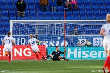 Team England forward Ellen White (18) looks on as her shot beats Team Germany goalie Almuth Schult (1)