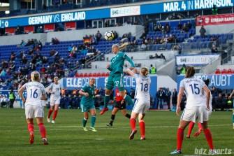 Team Germany forward Lea Schuller (27) gets a head on the ball
