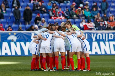 The England women's national soccer team starting XI huddle before the start of their game against the German women's national soccer team