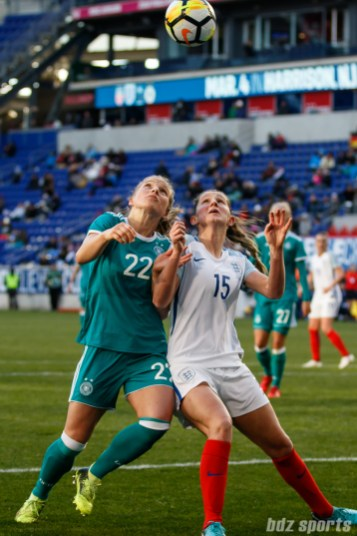 Team Germany midfielder Tabea Kemme (22) battles Team England defender Abby McManus (15) for the ball