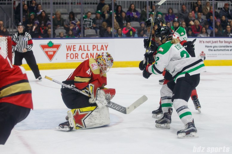 Kunlun Red Star goalie Noora Raty (41) holds on to the puck