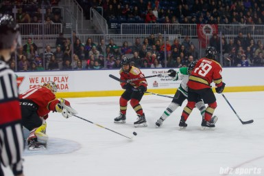 Kunlun Red Star goalie Noora Raty (41) pushes the puck away