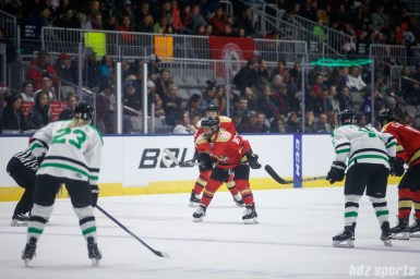 Kunlun Red Star forward Kelli Stack (16) gets ready for a face-off
