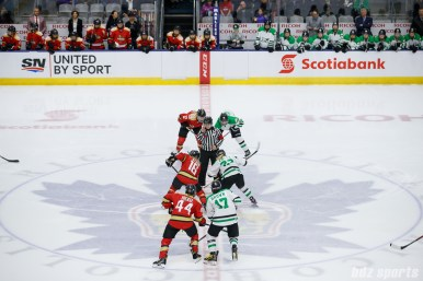 Kunlun Red Star forward Kelli Stack (16) and Markham Thunder forward Nicole Kosta (22) take the opening face-off