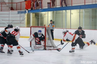 Kunlun Red Star defender Melanie Jue (6) takes an off-balanced shot on goal