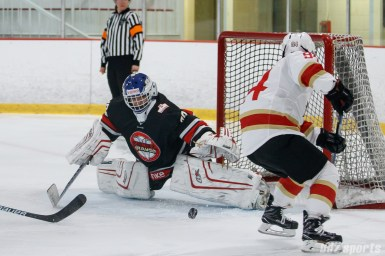 Vanke Rays goalie Tianyi Zhang (39) stretches out to cover the goal
