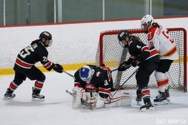 Vanke Rays goalie Tianyi Zhang (39) makes the stop