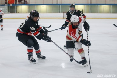 Kunlun Red Star forward Kelli Stack (16) looks to get around Vanke Rays defender Naixin Zhou (56)