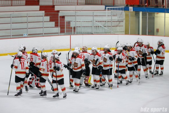 The Kunlun Red Star high five after completing their last 2017-2018 regular season game