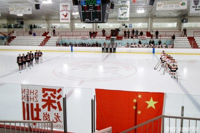 The Vanke Rays and Kunlun Red Star stand for the playing of the Chinese national anthem before the start of their game on March 11, 2018