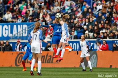 Olympique Lyon teammates, Team France midfielder Amandine Henry (6) and Team USA midfielder Morgan Brian (6), go up for a header