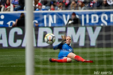 Team France forward Eugenie Le Sommer (9) look on after beating Team USA goalie Alyssa Naeher (1) to score the game tying goal
