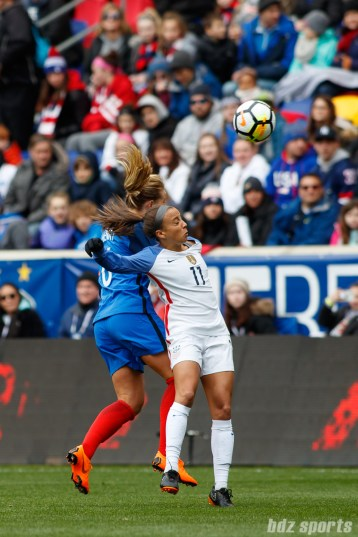 Team France midfielder Amandine Henry (6) challenges Team USA forward Mallory Pugh (11) for a ball in the air