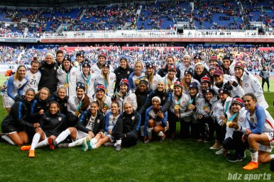 Players from Team USA soccer and Team USA hockey pose for a picture post-game on March 4, 2018
