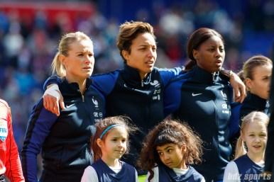 Team France midfielder Amandine Henry (6), goalie Sarah Bouhaddi (16), and defender Aissatou Tounkara (2)