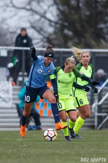 Sky Blue FC midfielder Carli Lloyd (10) and Seattle Reign FC midfielder Jessica Fishlock (10)