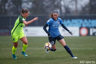Sky Blue FC forward Janine Beckie (12) and Seattle Reign FC defender Theresa Nielsen (8)