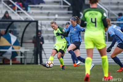 Seattle Reign FC midfielder Jessica Fishlock (10) and Sky Blue FC forward Janine Beckie (12)