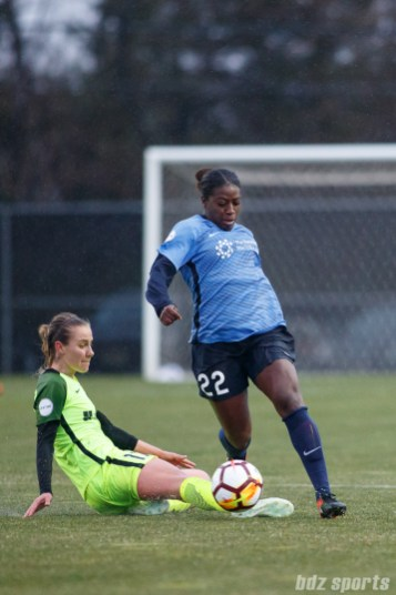 Sky Blue FC defender Mandy Freeman (22) and Seattle Reign FC midfielder Beverly Yanez (17)