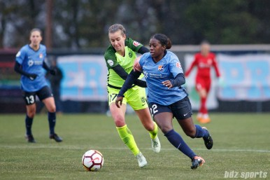 Seattle Reign FC midfielder Beverly Yanez (17) and Sky Blue FC defender Mandy Freeman (22)