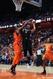 Las Vegas Aces forward Nia Coffey (12) and Connecticut Sun center Jonquel Jones (35)