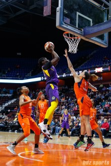 Los Angeles Sparks forward Shakayla Thomas (20) and Connecticut Sun guard Rachel Banham (1)