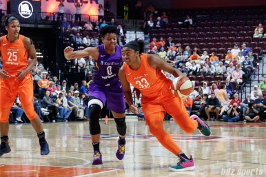 Connecticut Sun forward Morgan Tuck (33) and Los Angeles Sparks guard Alana Beard (0)