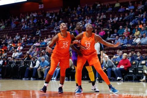 Connecticut Sun forward Alyssa Thomas (25) and Connecticut Sun forward Morgan Tuck (33) box out