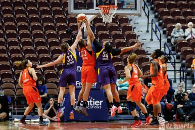 Los Angeles Sparks players Kathryn Westbeld (33) and Kaylee Jensen (54) go for the rebound against Connecticut Sun center Cayla George (23)