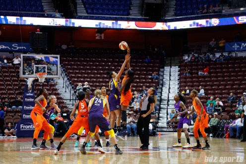 Los Angeles Sparks center Taya Reimer (22) and Connecticut Sun forward Chiney Ogwumike (13) take the opening tip-off