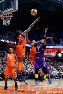 Connecticut Sun forward Chiney Ogwumike (13) and Los Angeles Sparks guard Odyssey Sims (1)