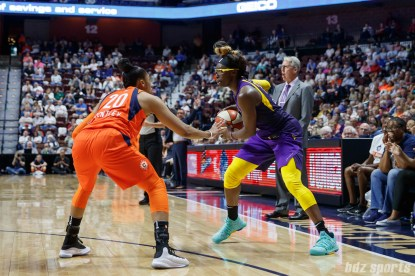 Los Angeles Sparks forward Essence Carson (17) and Connecticut Sun guard Alex Bentley (20)