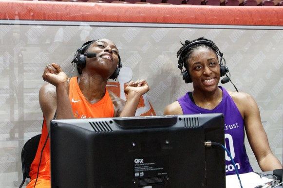 Connecticut Sun forward and ESPN analyst Chiney Ogwumike (13) interviews sister Los Angeles Sparks forward Nneka Ogwumike (30) post-game