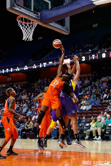 Connecticut Sun forward Chiney Ogwumike (13) reaches for the rebound