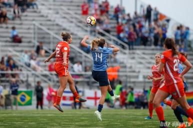 Houston Dash defender Amber Brooks (22) and Sky Blue FC forward Katie Johnson (14)