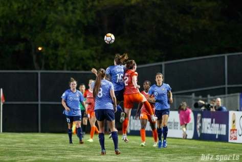 iSky Blue FC midfielder Sarah Killion (16) and Houston Dash forward Veronica Latsko (12)