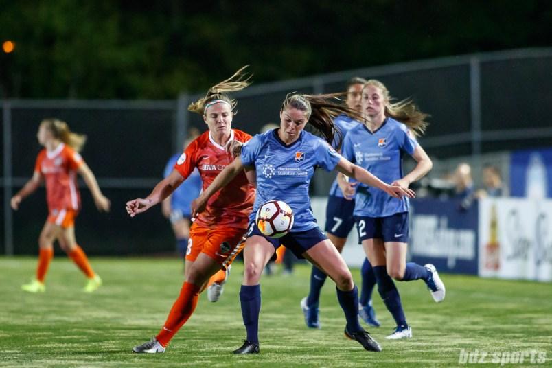 Houston Dash forward Savannah Jordan (13) and Sky Blue FC defender Erica Skroski (8)