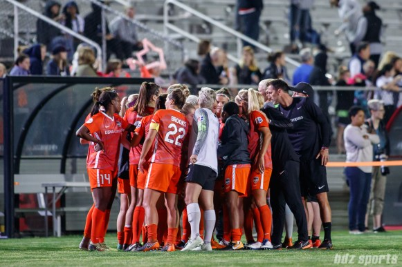 The Houston Dash huddle after the game