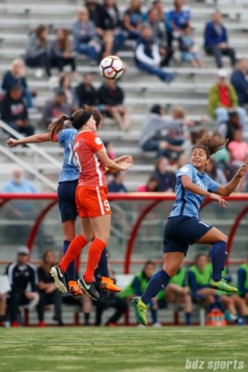 Sky Blue FC midfielder Carli Lloyd (10) and Houston Dash midfielder Haley Hanson (9)