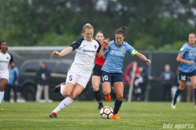 North Carolina Courage midfielder Samantha Mewis (5) and Sky Blue FC midfielder Carli Lloyd (10)