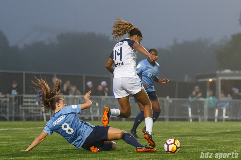 Sky Blue FC defender Erica Skroski (8) and North Carolina Courage forward Jessica McDonald (14)