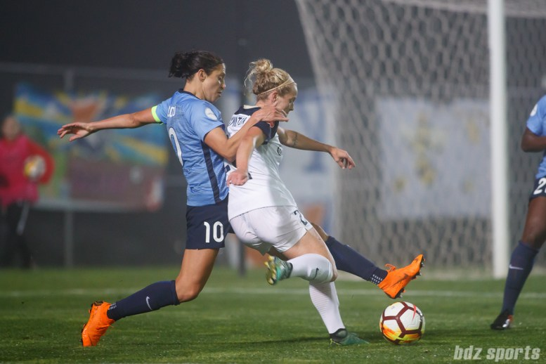 Sky Blue FC midfielder Carli Lloyd (10) and North Carolina Courage forward Kristen Hamilton (23)