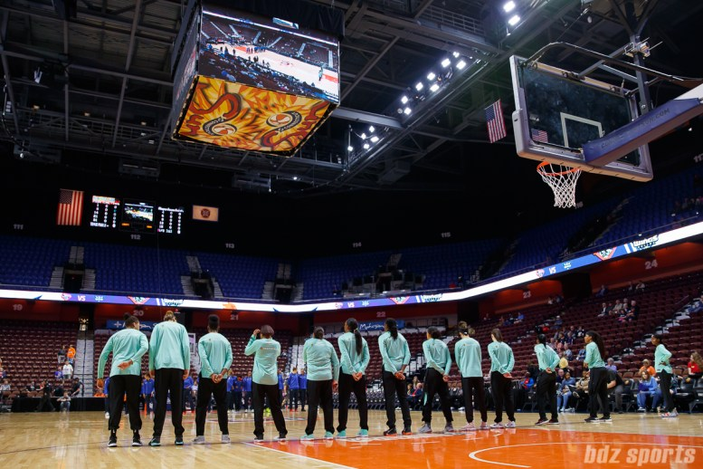 New York Liberty line up for the playing of the national anthem
